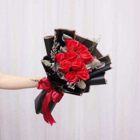 Someone holding a Vin Florist's Karen bouquet