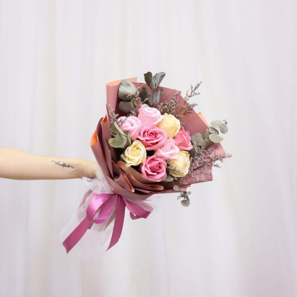 Someone holding a Vin Florist's Magenta Pink bouquet