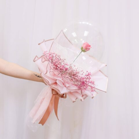 Someone holding a Vin Florist's Soap Rose in Da Ball Flower