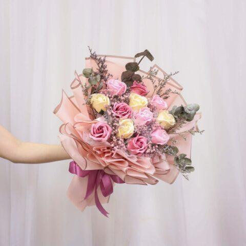 Someone holding a Vin Florist's Varda flower