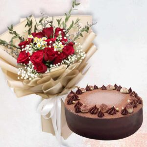 Red rose in golden wrapping and a choco raspberry cake