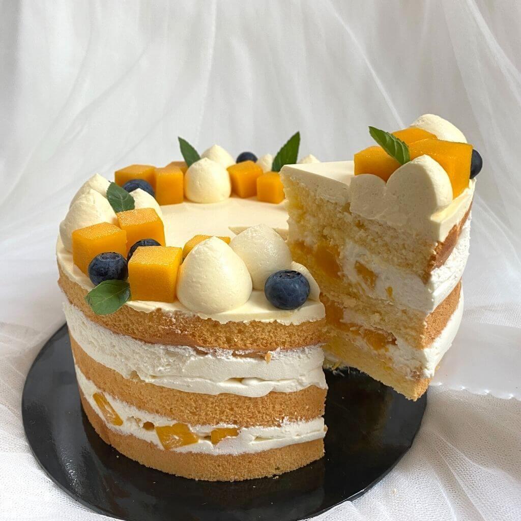 Slicing of Mango Passion Fruit Cake